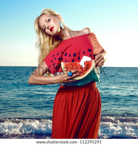 Fashion portrait of young beauty woman with watermelon at sea
