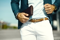 Fashion portrait of young businessman handsome  model man in casual cloth suit with accessories on hands
