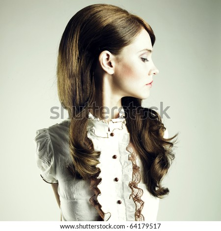 Fashion portrait of young elegant brunette girl