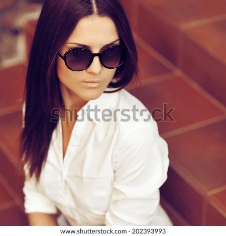 Fashion portrait of young pretty woman in sunglasses #202393993