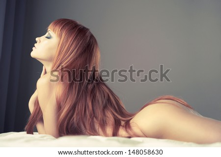 Fashion portrait of young sensual woman in bed