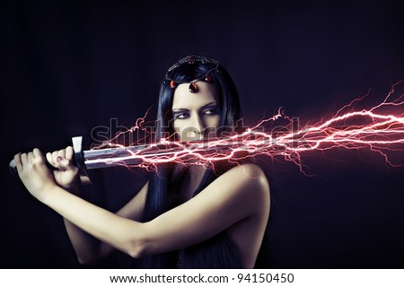 Fashion portrait of young sexy brunette woman - storm. Weather - flash lightning on her sword. mythology, fairytale or fantasy world.