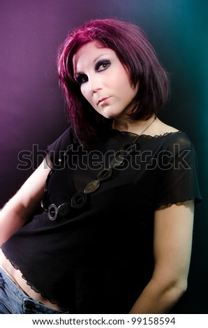 Fashion portrait of young woman with red hair and disco lights