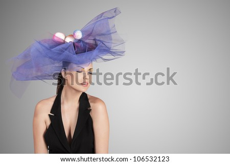 Fashion portrait of young woman with stylish hat
