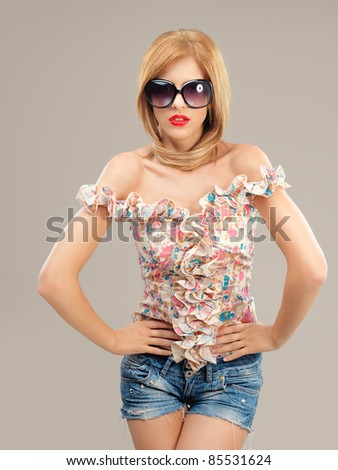 fashion portrait sexy woman sunglasses, jeans shorts posing