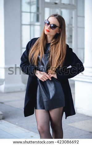 Fashion portrait stylish pretty woman in sunglasses outdoor. Young smiling woman wearing a rock black style having fun in city. Street fashion. Red lipstick. #423086692