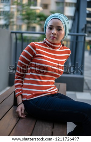 c8de9ba02fd Fashion portraiture of a beautiful young asian woman wearing jeans