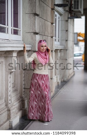 Fashion portraiture of young beautiful muslim woman wearing hijab. Image contain certain grain or noise and soft focus.