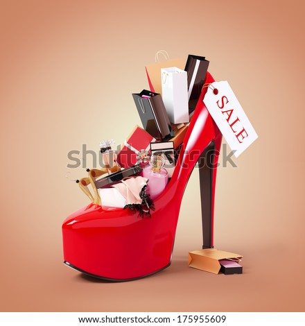 Fashion purchases into a woman's shoe. Sale - Shutterstock ID 175955609