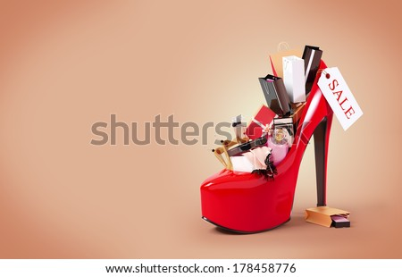 Fashion purchases into a woman's shoe. Sale - Shutterstock ID 178458776
