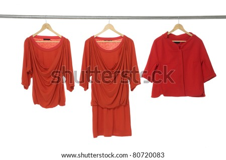 Fashion red clothing hanging on hangers