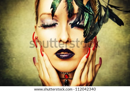 Fashion retro portrait of woman with dark makeup and red nails