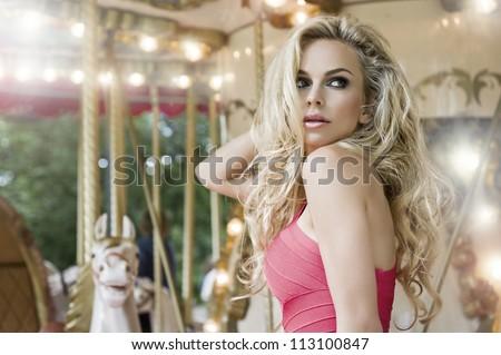 Fashion sensual model posing on carousel