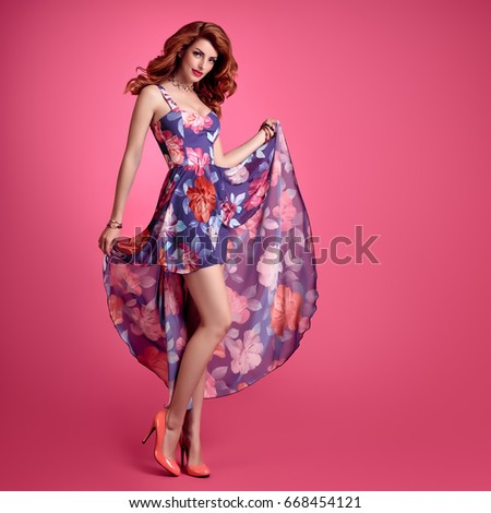 aba0fad6e Fashion Sensual Sexy Redhead Model Smiling. Beauty Woman in Summer Outfit.  Trendy Floral Dress