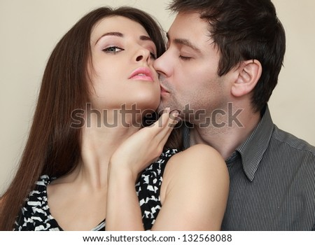 Fashion sexy couple hugging and kissing. Closeup portrait