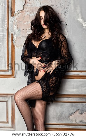 5b076651be0 fashion sexy young woman in black lacy lingerie and stockings posing on old  wall  565902796