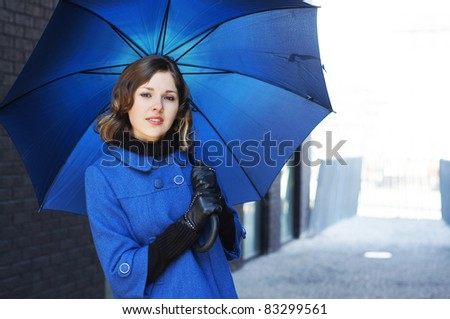 Fashion shoot of young attractive woman with umbrella