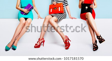 Fashion shopping image with colourful styles. 3 women sitting together on the bench.  #1017181570