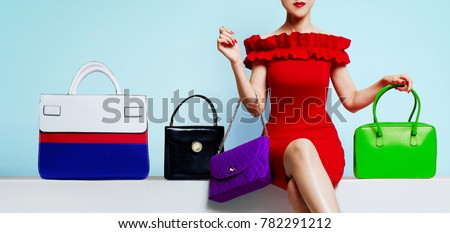 Fashion shopping image. Woman with red dress sitting with many bags.