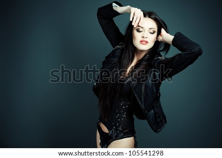 Fashion shot beautiful sexy girl in lingerie and leather jacket on top