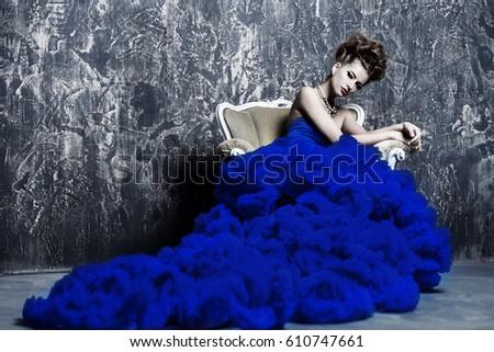 Fashion shot. Beautiful young woman wearing luxurious long dress and necklace. Luxury, rich lifestyle. Jewellery.  #610747661