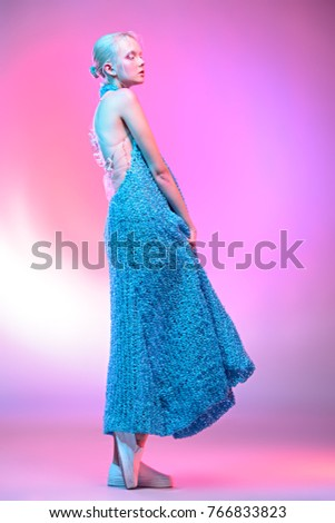 Fashion shot of a beautiful female model posing in designer clothes collection over pink background. Female beauty. Studio shot. #766833823
