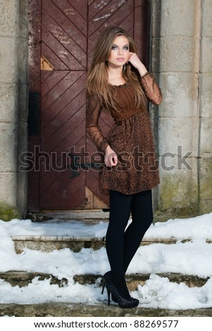 fashion shot of a beautiful young woman in winter