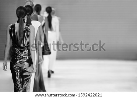 Fashion show, catwalk event, models on the runway.