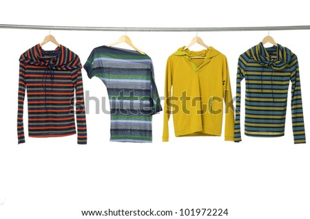 Fashion striped Shirt clothing hanging on hangers