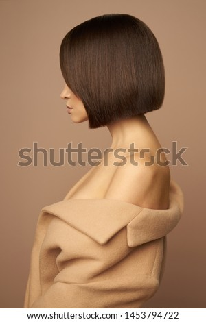 Fashion studio photo of young beautiful lady in beige coat on beige background. Total beige. Fashion look book. Warm Autumn. Warm Spring #1453794722
