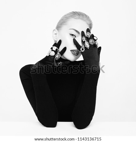 Fashion studio portrait of beautiful blonde lady with lot of precious rings