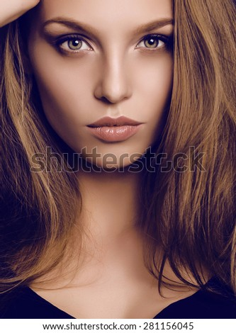 fashion studio portrait of beautiful young woman with dark hair and green eyes
