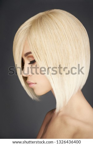 Fashion studio portrait of lovely asian woman with blonde short hair. Fashion and beauty. Bright makeup. Fashionable haircut. Sexy young model with beautiful eyes