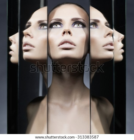 Stock Photo Fashion studio portrait of woman and mirrors on black background