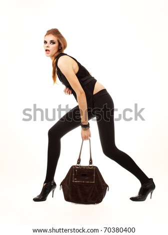 Fashion studio shot of beautiful woman with brown bag on white background