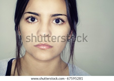 Fashion style close up portrait of young woman's face - stock photo