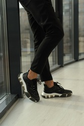 fashion. style. footwear. men's sneakers black on the feet