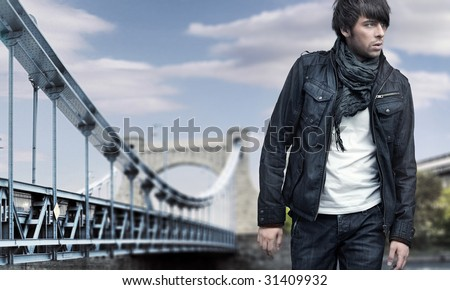 Fashion style photo of a handsome man walking - stock photo