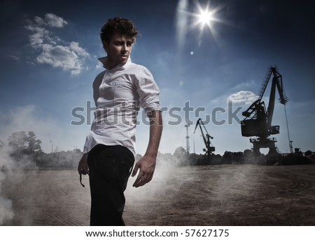 Fashion style photo of a handsome man walking