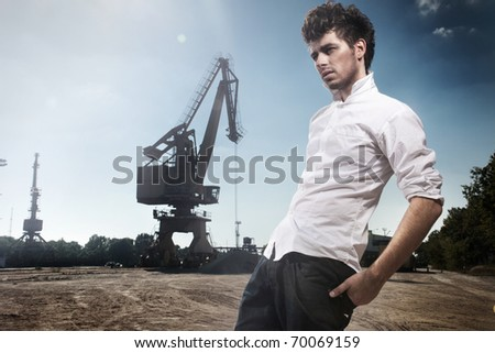 Fashion style photo of a handsome man walking in dock