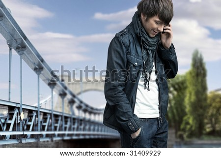 Fashion style photo of a man talking over cellphone