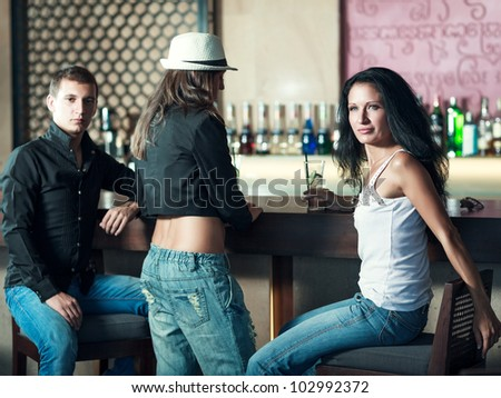 Fashion style photo of a people in the bar