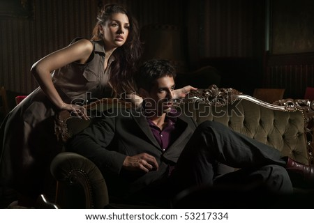 Fashion style photo of an attractive pair posing #53217334