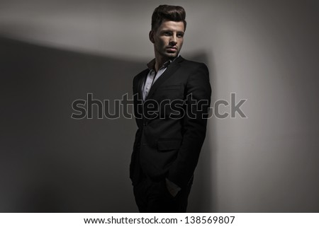 Fashion style photo of young guy - stock photo