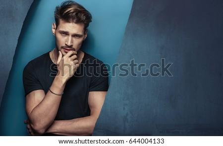Fashion style portrait of a muscular, handsome guy