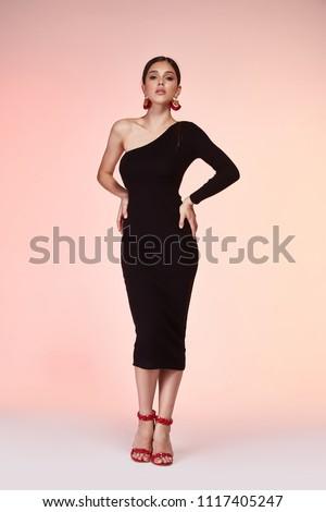 Fashion style woman perfect body shape brunette hair wear black skinny sexy dress elegance casual beautiful model secretary office uniform stewardess business lady party date jewelry earrings shoes.