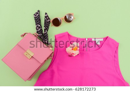 Fashion. Summer woman accessories-Summer red clothes,sunglasses, shoes ,bag on green background