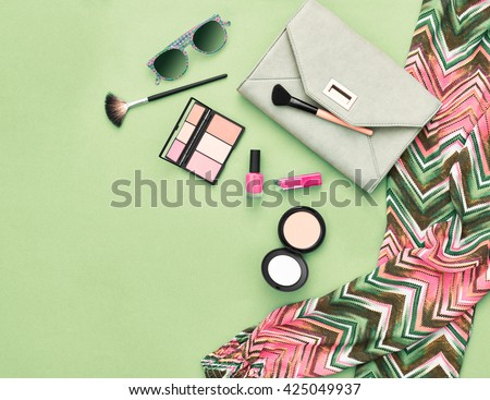 Shutterstock Fashion. Summer woman accessories.Unusual fashion overhead, top view. Summer clothes, cosmetics,makeup accessories fashion set.Urban fashion summer colorful outfit.Stylish handbag clutch, sunglasses.