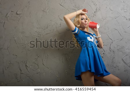 Stock Photo Fashion swag portrait of pretty glamor stylish blond young woman model  drinking from a red cup cola