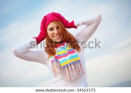 Fashion teenage girl wearing spring clothing over sky